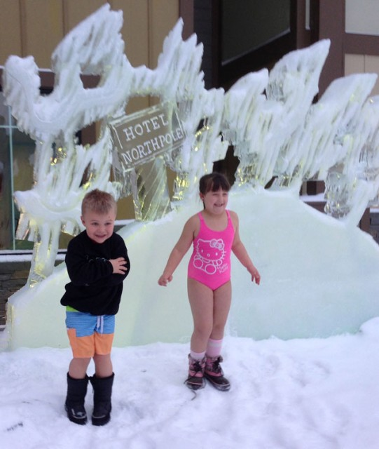 Kids chillin' in front of the hotel ice sculpture.